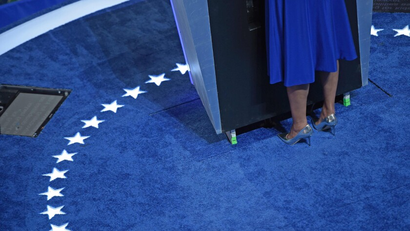 According to Footwear News, Michelle Obama chose to deliver her convention speech in a pair of metallic Jimmy Choo pumps.