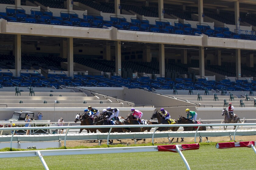 Opening day at the Del Mar Racetrack happened in front of empty grandstand.