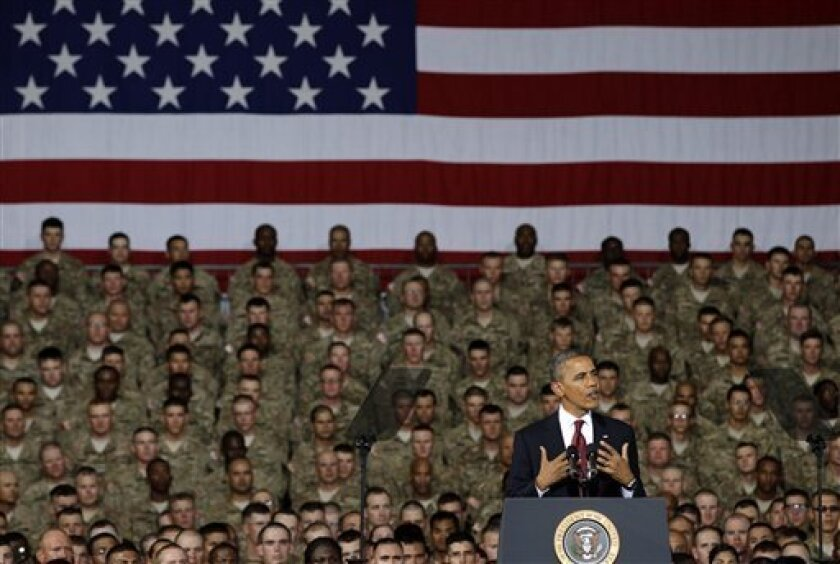 President Barack Obama speaks to troops, service-members and military families at the 1st Aviation Support Battalion Hangar at Fort Bliss Friday, Aug. 31, 2012, in El Paso, Texas. (AP Photo/Tony Gutierrez)