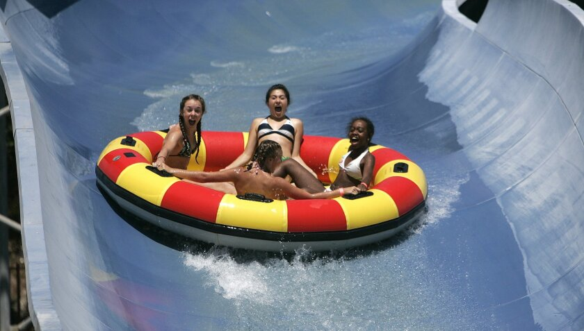 2009 Camp Beyond the Scars attendees (clockwise from left) Nicole Gleason, Ashley Acosta, Kania Payne and Jessica Capoocia hung on for dear life while coming down a water slide at Knott's Soak City in Chula Vista yesterday. (Earnie Grafton / Union-Tribune)