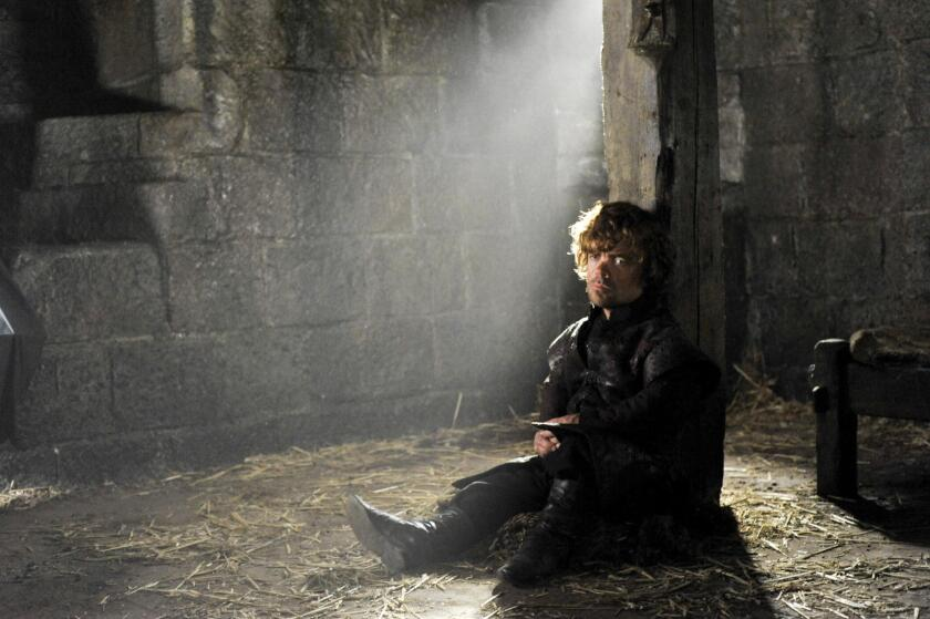 """HBO, a unit of Time Warner, is reducing its workforce by about 7%. HBO produces such shows as """"Game of Thrones,"""" pictured here with Peter Dinklage."""