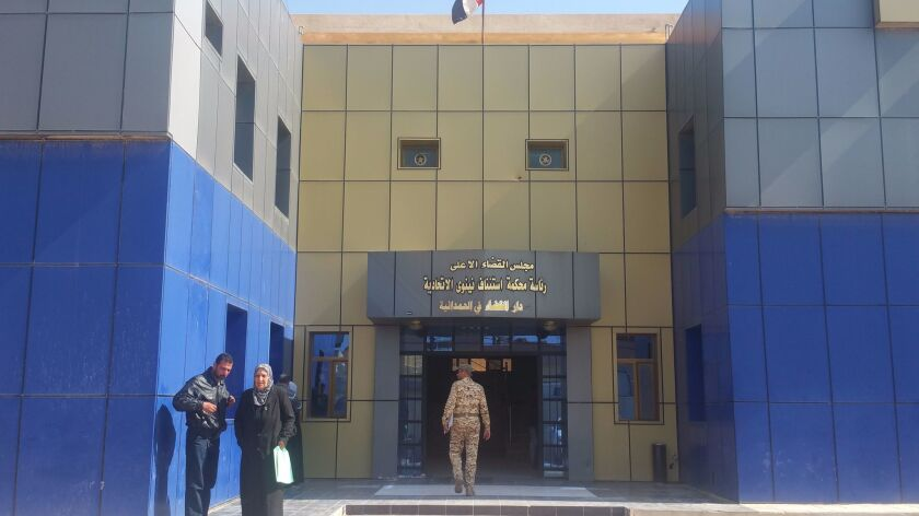 The entrance to the Hamdaniya, Iraq, courthouse, which now shares space with Mosul's judiciary.