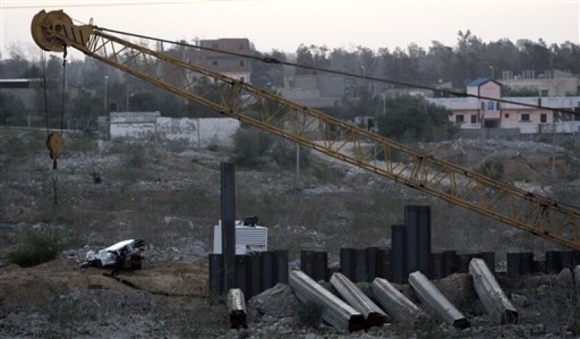 Metal slabs lay on the ground on the Egyptian side of the border where Egypt has started installing a barrier meant to stop smuggling goods and weapons to Gaza, as seen from Rafah, southern Gaza Strip, Monday, Jan. 4, 2010.The steel barrier is meant to slice through hundreds of smuggling tunnels under the 14-kilometer-long (nine-mile) Gaza-Egypt border. Once completed, it would cut off the blockaded territory's last lifeline and could increase pressure on Gaza's Hamas rulers to moderate.(AP Photo/Hatem Moussa)