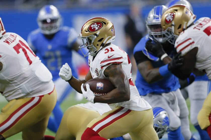 San Francisco 49ers running back Raheem Mostert runs against the Detroit Lions in the first half of an NFL football game in Detroit, Sunday, Sept. 12, 2021. Mostert will undergo season-ending surgery on his knee after getting injured in the season opener Sunday, (AP Photo/Duane Burleson)