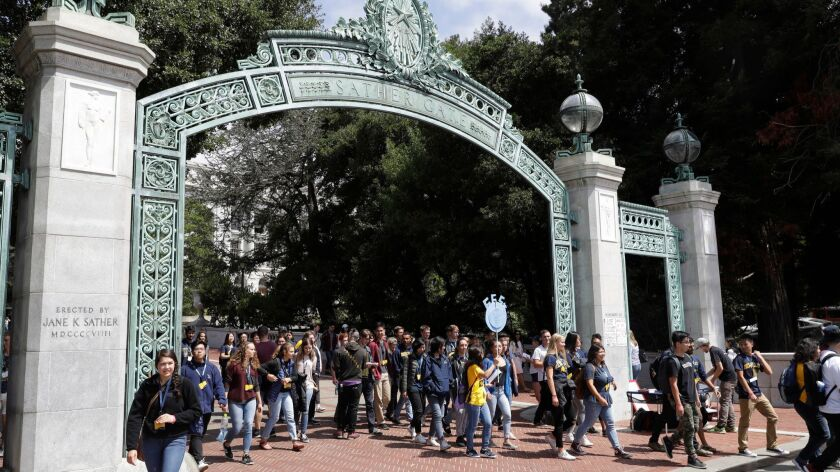FILE - In this Aug. 15, 2017 file photo, students walk on the University of California, Berkeley cam