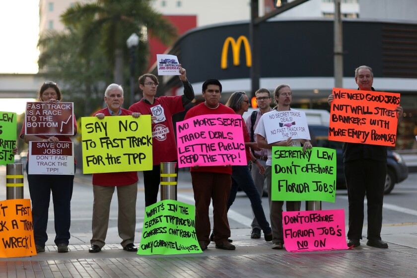 Protesters rally against the Trans-Pacific Partnership last month in Miami.