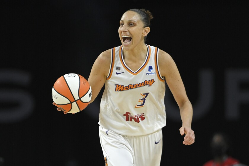 Phoenix Mercury guard Diana Taurasi (3) calls a play as she brings the up court against the Las Vegas Aces during the second half of Game 2 in the semifinals of the WNBA playoffs Thursday, Sept. 30, 2021, in Las Vegas. (AP Photo/David Becker)