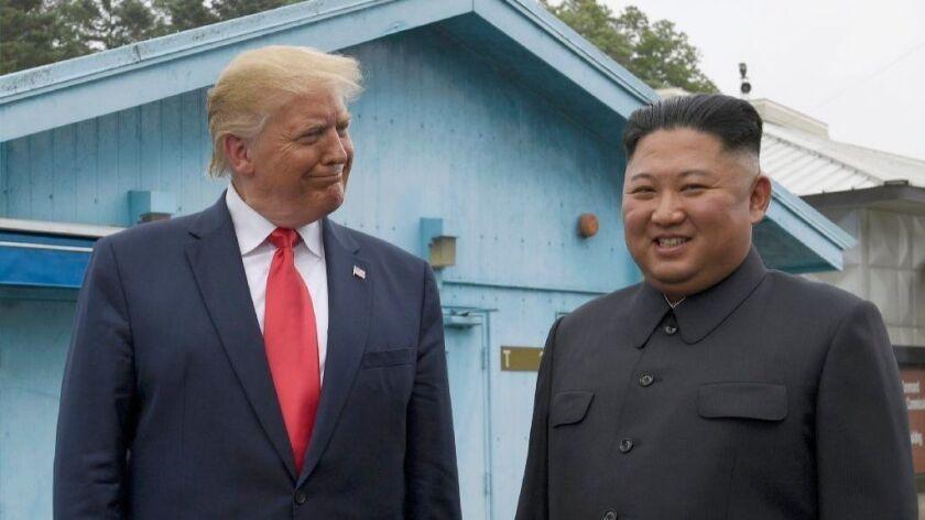 President Trump and North Korean leader Kim Jong Un in the demilitarized zone Sunday.