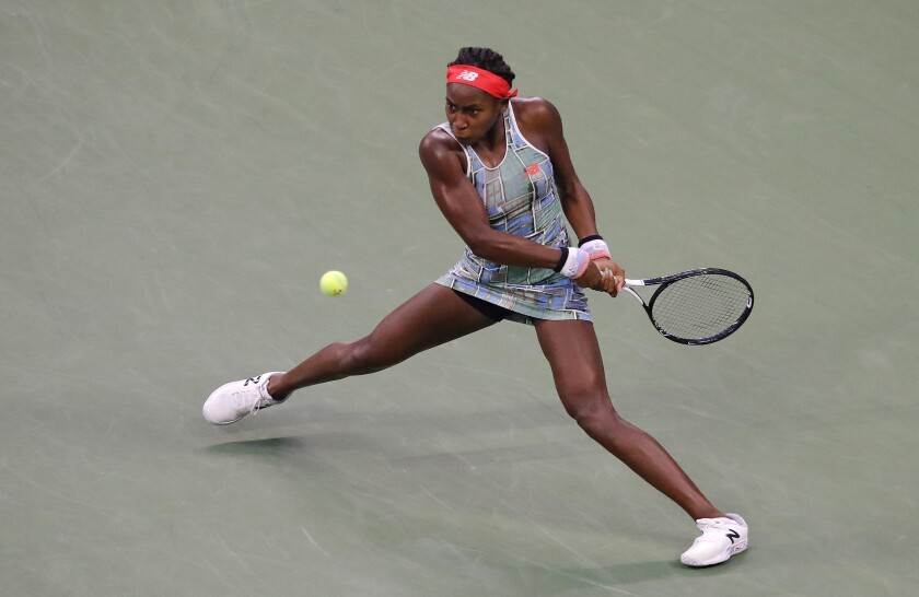 Coco Gauff returns a shot during her match against Anastasia Potapova in the first round of the U.S. Open on Tuesday.