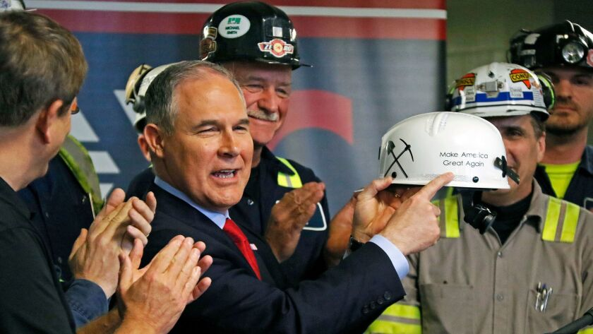 EPA Administrator Scott Pruitt holds up a hardhat he was given during a visit to the Consol Pennsylv