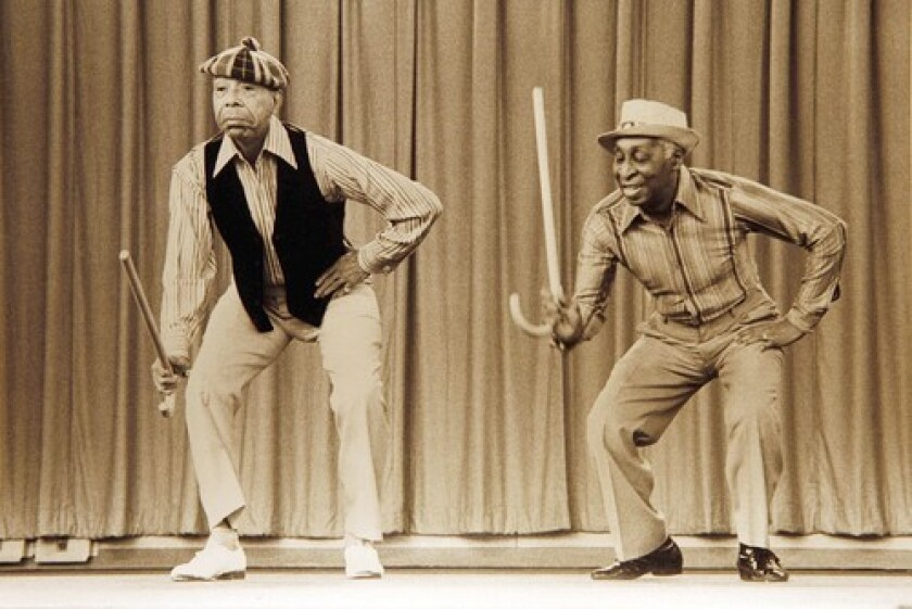 Ernest Brown, right, and his partner Charles Cook played all over the world with performers such as Duke Ellington, Count Basie and Lena Horne on the vaudeville circuit. Cook died in 1991.