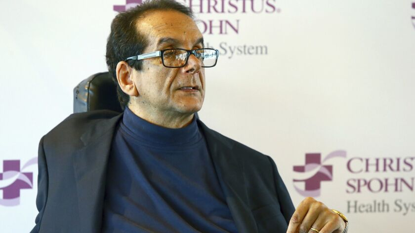 FILE - In this March 31, 2015, file photo, Charles Krauthammer talks about getting into politics dur