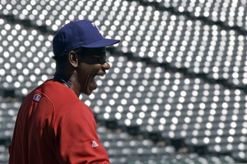 Texas Rangers manger Ron Washington reacts during batting practice Friday, Oct. 8, 2010, in Arlington, Texas. The Rangers host the Tampa Bay Rays in Game 3 of baseball's American League Division Series on Saturday. (AP Photo/David J. Phillip)