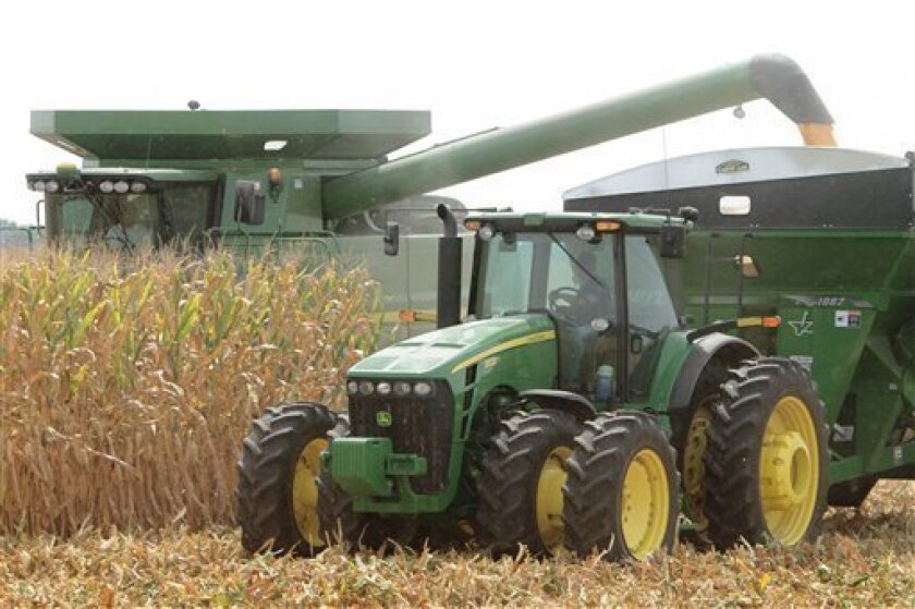 In this photo taken Aug. 30, 2011, corn crops are harvested near Farmingdale, Ill. Food prices could rise next year because an unseasonably hot summer likely damaged much of this year's corn crop.(AP Photo/Seth Perlman)