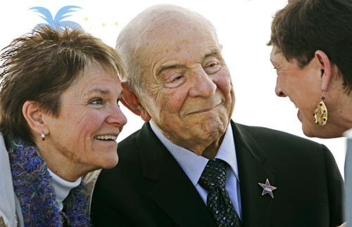 On his 90th birthday in January 2007, Carl Karcher, founder of the Carl's Jr. restaurants, receives a star on the Anaheim/Orange County Walk of Stars. His niece Mary Harrigan is at left. At right is Sue O'Donnell, who worked at one of his original restaurants.