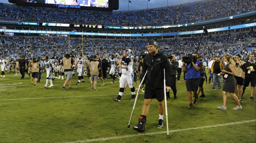 Panthers tight end Greg Olsen leaves the field after Sunday's game against the Cowboys.