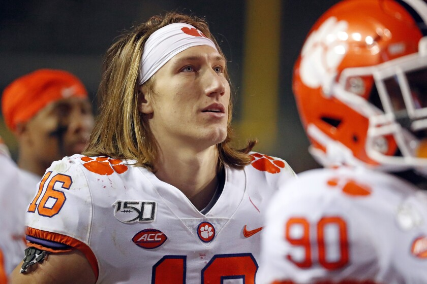 Clemson's Trevor Lawrence (16) watches the fourth quarter from the sideline during the second half of an NCAA college football game against North Carolina State in Raleigh, N.C., Saturday, Nov. 9, 2019. (AP Photo/Karl B DeBlaker)