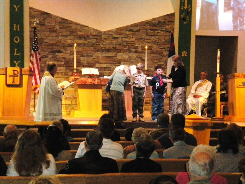 Boy Scouts Luke Huhn and Bradley Schulze received their God and Me Award; Jake Huhn received a God and Church Award during a  service at Community Lutheran Church in Escondido