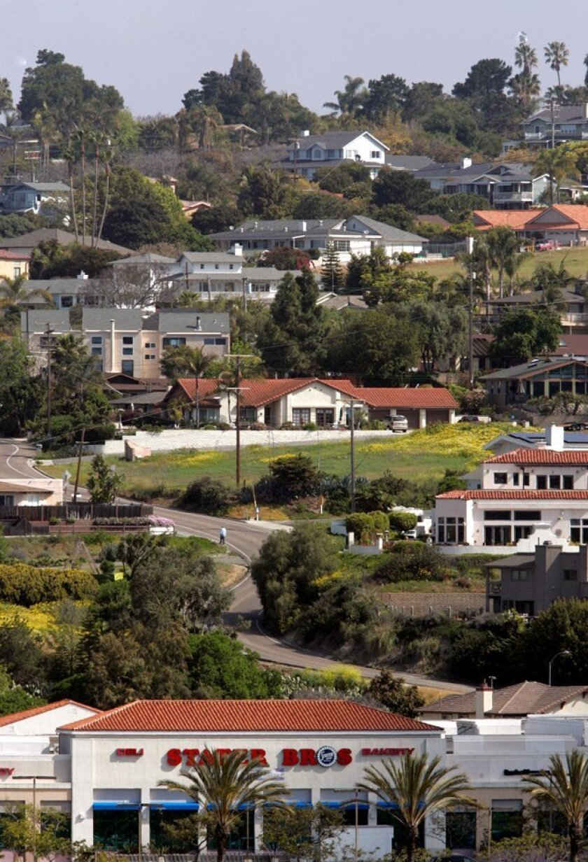 With a mix of mini-mansions and modest homes and winding, hilly streets rising above a shopping center, Fire Mountain is one of Oceanside's most distinctive neighborhoods.