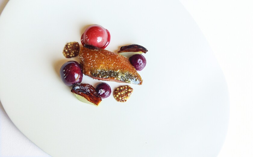 The gorgeous pigeon rôti at Addison, with cabbage, cherries and pickled mustard.