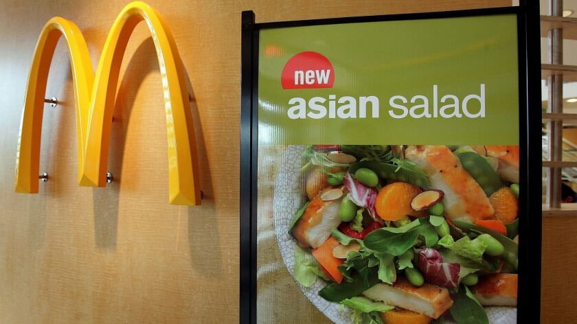 McDonald's halted sales Friday of salad items in 3,000 franchises in the Midwest, after an outbreak of a parasite-borne illness was linked to its greens in Illinois and Iowa.