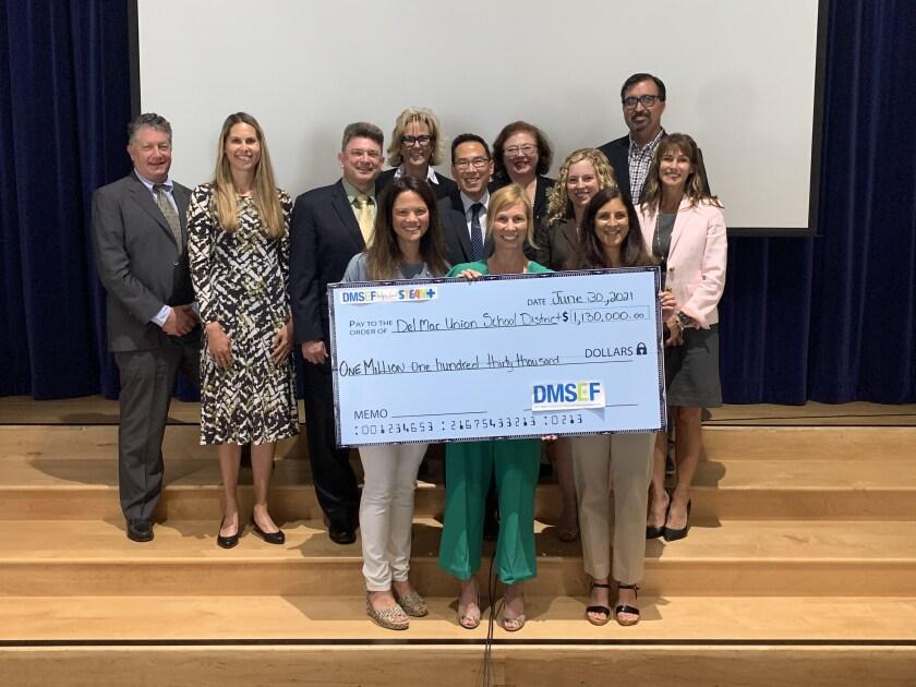 DMSEF presented a check to the Del Mar Union School District board on June 30.