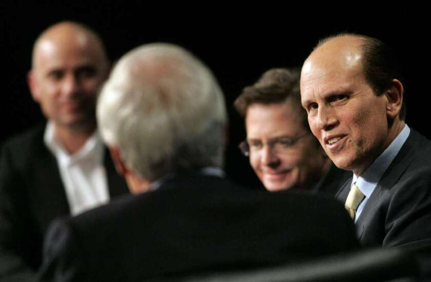 Big wheels in philanthropy, but are they conservatives or liberals? From left, Andre Agassi, Ted Turner, Michael J. Fox and Michael Milken at a 2007 Milken Institute discussion of public figure philanthropy.