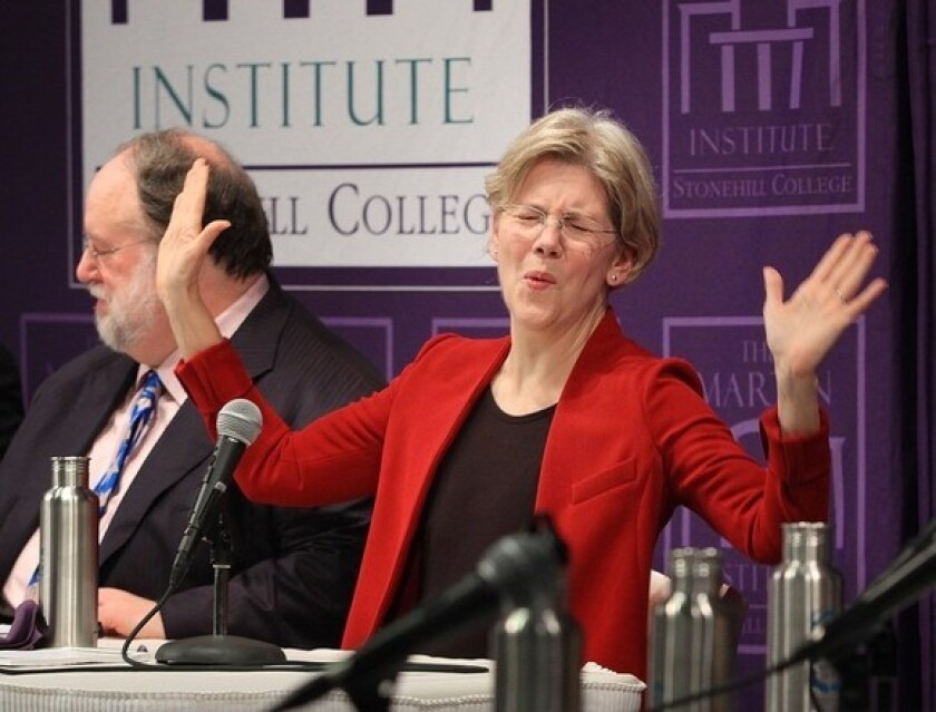 Elizabeth Warren gestures during a forum at Stonehill College in Easton, Mass., on Tuesday.