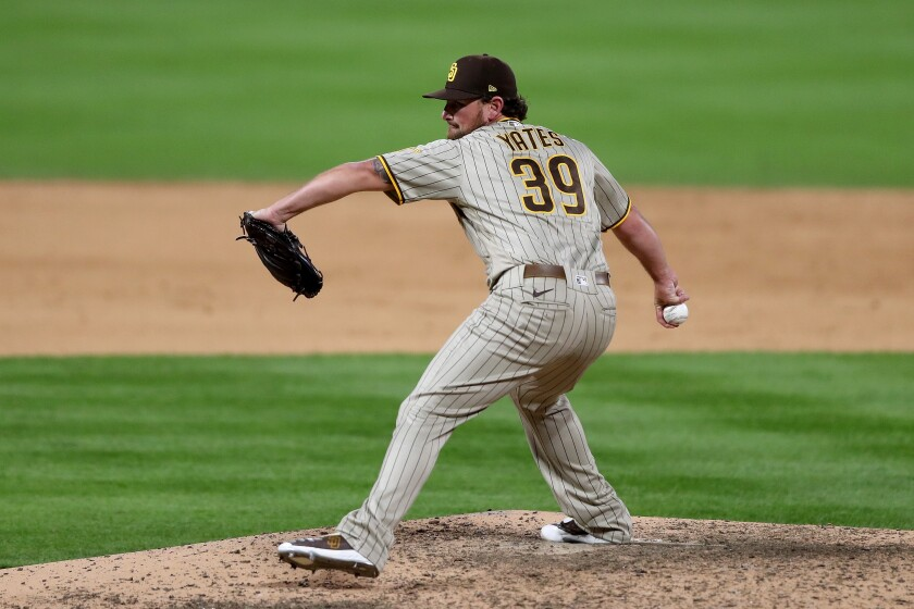 Kirby Yates #39 of the San Diego Padres throws in the ninth inning against the Colorado Rockies
