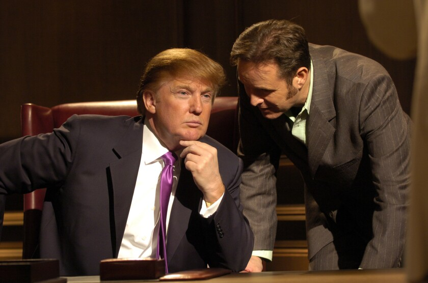 "Donald Trump and Mark Burnett confer during a boardroom scene in the first season of ""The Apprentice,"" shot in 2004."