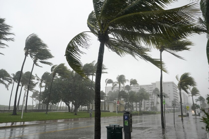 A normally bustling Ocean Drive is shown during a downpour, Sunday, Nov. 8, 2020, on Miami Beach, Florida's famed South Beach. A strengthening Tropical Storm Eta cut across Cuba on Sunday, and forecasters say it's likely to be a hurricane before hitting the Florida Keys Sunday night or Monday. (AP Photo/Wilfredo Lee)
