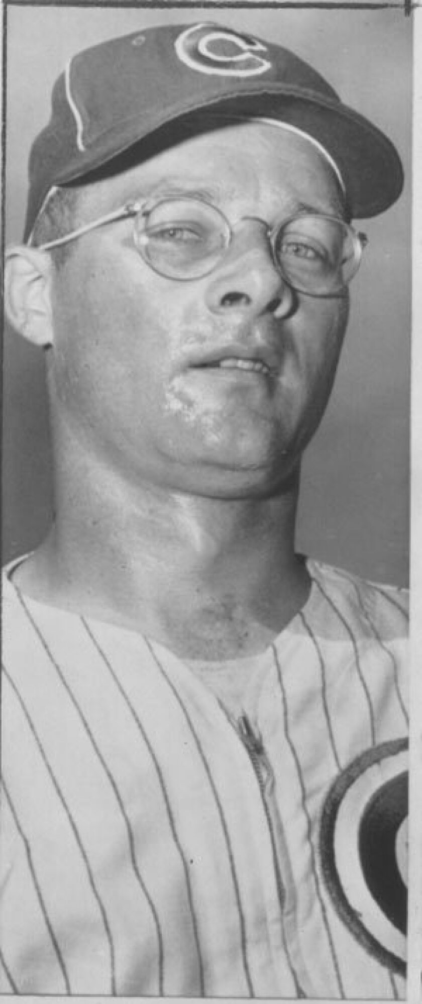 """1958 photo of Chicago Cubs pitcher Jim Brosnan. Brosnan had off-season work at a Chicago ad agency and wrote """"The Long Season"""" and """"Pennant Race."""""""