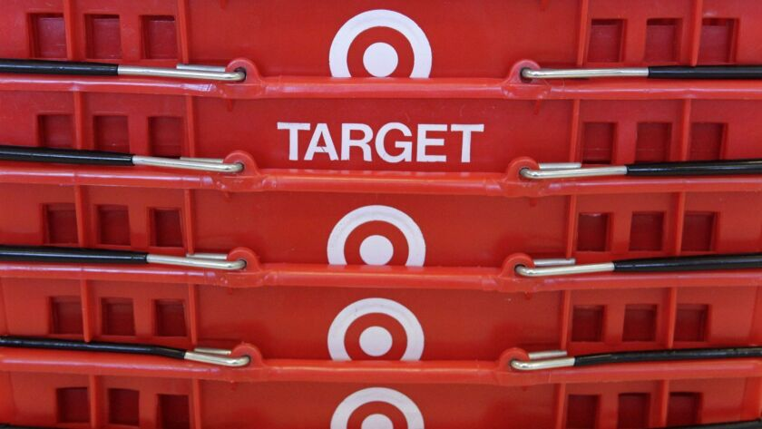 FILE - In this May 20, 2009 file photo, shopping baskets are stacked at a Chicago area Target store.