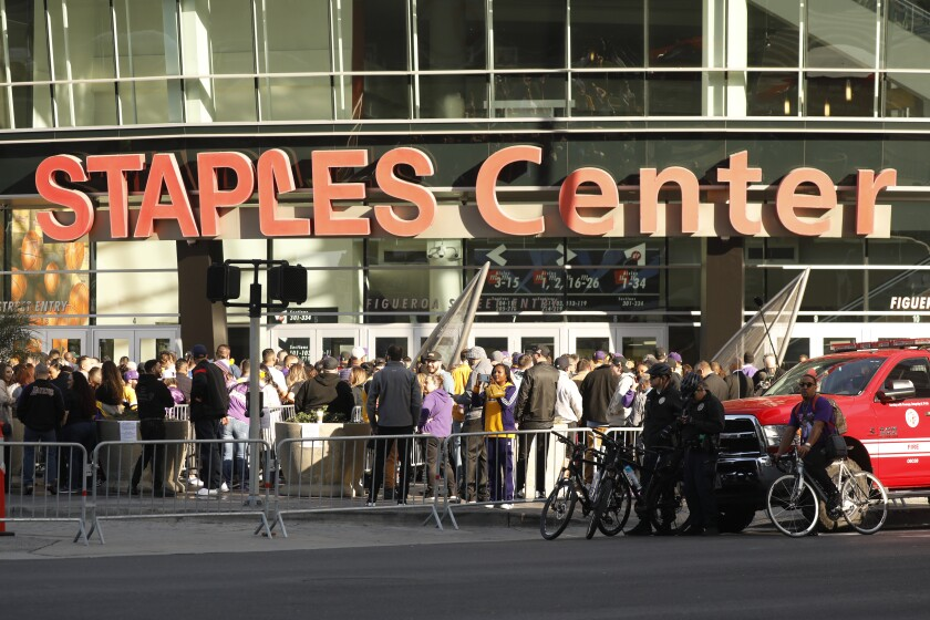 LOS ANGELES CA FEBRUARY 24, 2020 -- Fans gather outside Staples Center the the 'Celebration of Life' for Kobe and Gianna Bryant, honoring the late NBA legend and his 13-year-old daughterwho died along with seven others in a helicopter crash in Calabasas last month. (Al Seib / Los Angeles Times)