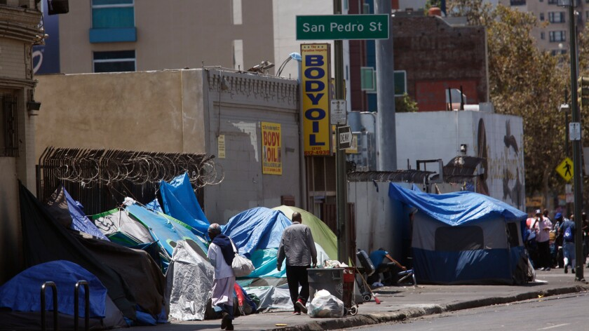Tents line the sidewalks along 5th Street in skid row in Los Angeles on July 5.