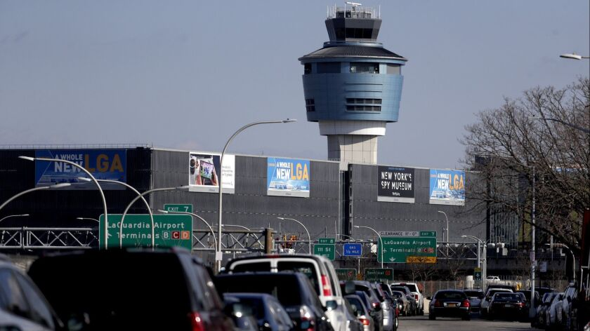 The air traffic control tower at LaGuardia Airport is seen, Friday, Jan. 25, 2019, in New York. The