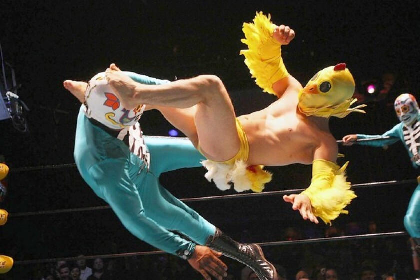 Lucha VaVoom has Mexican wrestlers, burlesque and comedy. And it flies at you fast.