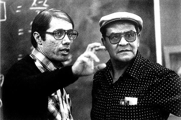 """Actor Edward James Olmos, left, compares notes with teacher Jaime Escalante during the filming of """"Stand And Deliver"""" in 1988. Escalante died Tuesday at his son's home in Roseville, Calif. He was 79."""