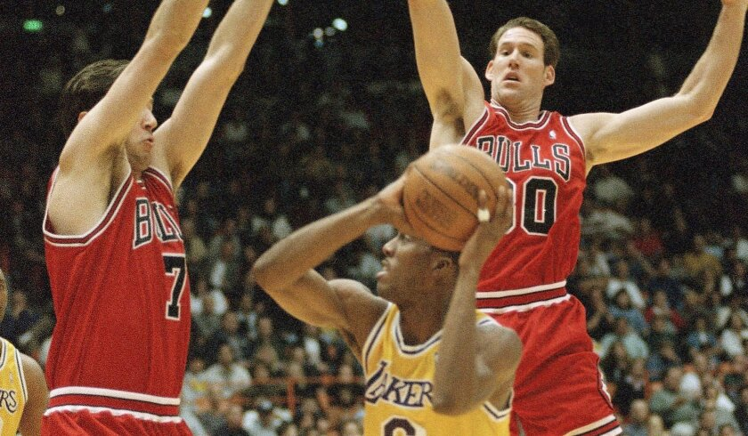 Jud Buechler (far right) played 12 years in the NBA, winning three title rings with the Bulls