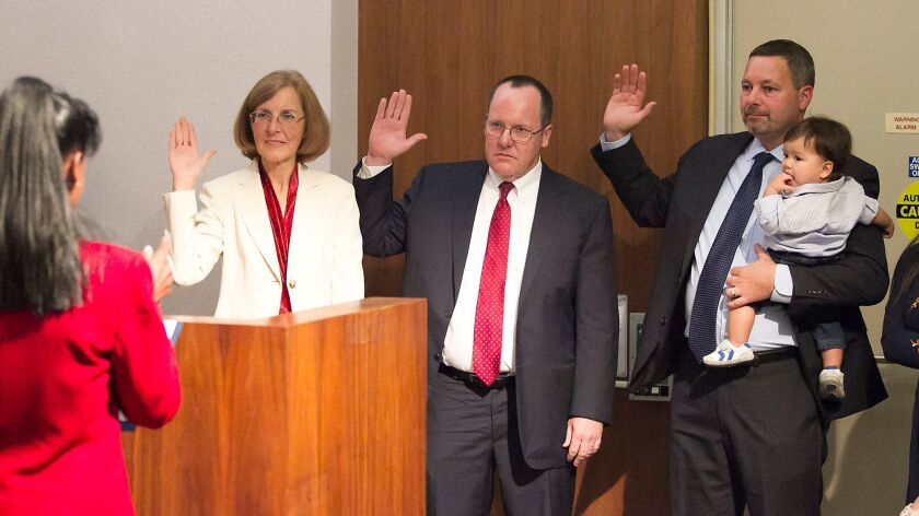 Council member incumbent Sandy Genis, newly elected John Stephens, and former councilman Alan Mansoo