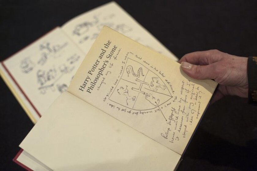 """J.K. Rowling's notes in the first edition of """"Harry Potter and the Philosopher's Stone,"""" as it was published in England, being auctioned by the writers' rights charity PEN."""