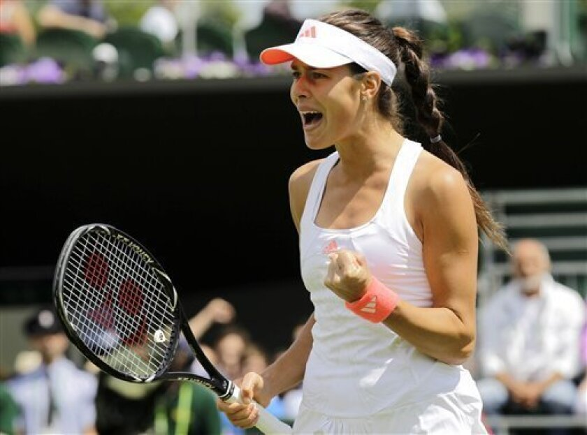 Serbia's Ana Ivanovic reacts during the match against Eleni Daniilidou of Greece at the All England Lawn Tennis Championships at Wimbledon, Thursday, June 23, 2011. (AP Photo/Sang Tan)