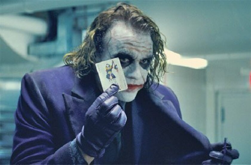 """A wave of downloading and streaming sites has made it easy for computer users to watch Heath Ledger in """"The Dark Knight."""" (Warner Bros.)"""