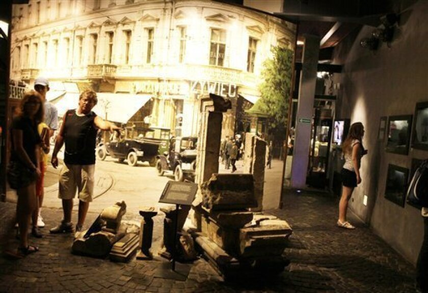 In this Aug. 26, 2009 photo, masonry from Warsaw's Royal Castle, the historic seat of Poland's monarchs destroyed in World War II, confronts visitors at the Warsaw Uprising Museum reminding them of the profound suffering borne by the nation during more than five years at Nazi hands, in Warsaw, Poland. In this country with tragic history going back centuries, World War II remains a memory much more vivid than to many Western Europeans or Americans: The devastation remains visible in bullet scars on buildings, street plaques marking execution sites and other reminders of physical devastation, as well as the pain still felt by most families of having lost loved ones to the fighting, concentration camps or forced labor. (AP Photo/Czarek Sokolowski)