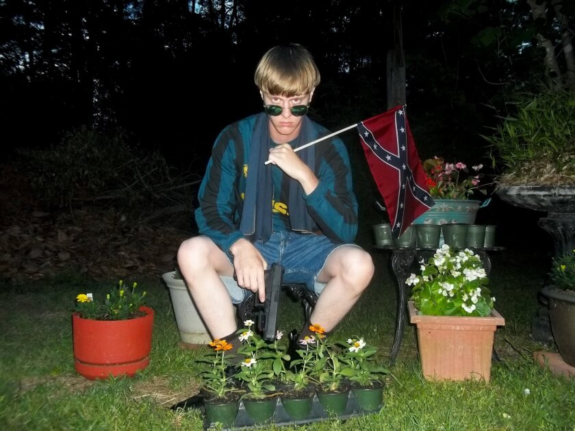 Dylann Roof, the 21-year-old accused of killing nine people inside a church in Charleston, S.C., should not have been cleared to purchase a gun because he had been arrested for possession of drugs, the FBI says. Roof is pictured on Lastrhodesian.com.