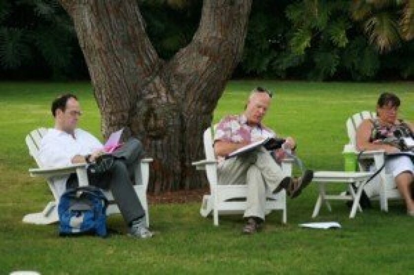 attendees engage in a writing exercise at a previous La Jolla Writers conference.