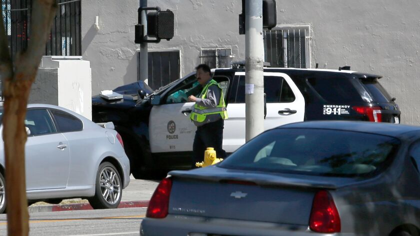 A police cruiser crashed near the intersection of 77th and San Pedro streets in Los Angeles,