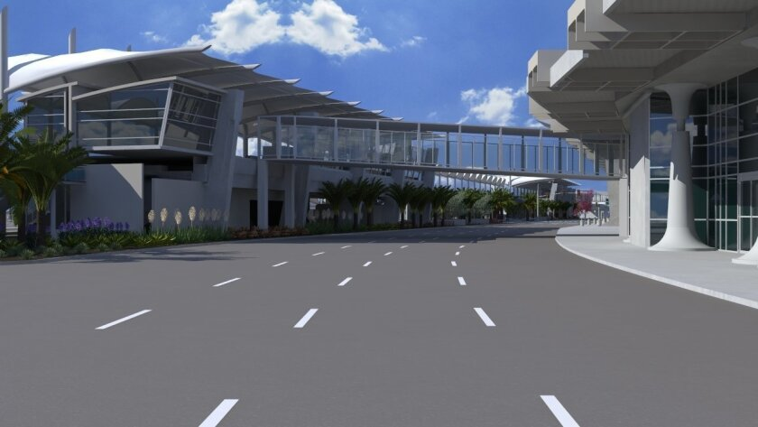 At San Diego International Airport's Terminal 2 West, the arrival lanes. To the back is the elevated roadway that will be reserved for dropping off departing passengers.