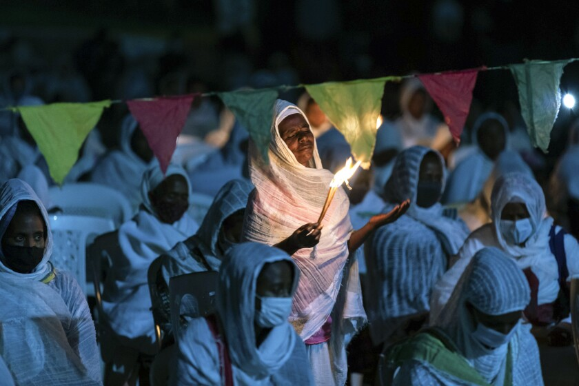 Ethiopian Orthodox Christians light candles and pray for peace.