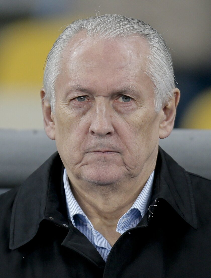 FILE - In this Monday, March 28, 2016 file photo, Ukrainian  head coach  Mykhaylo Fomenko listens to the national anthems ahead of the international friendly soccer match between  Ukraine and Wales at the Olympiyskiy stadium in Kiev, Ukraine. (AP Photo/Efrem Lukatsky, File)